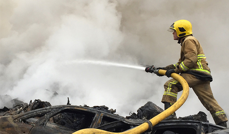 firefighter in action with hose image