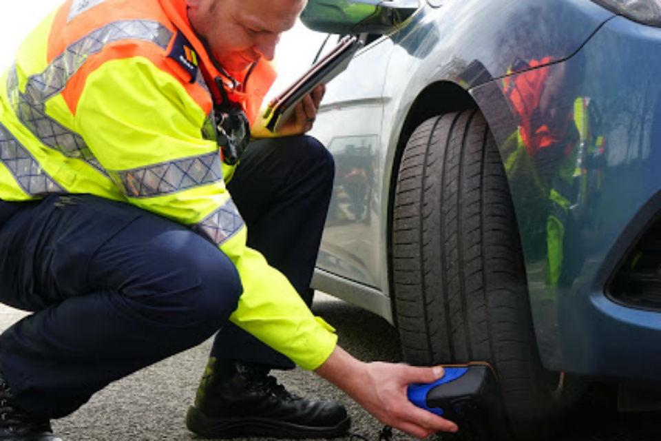 Man Checking Tyre Tread