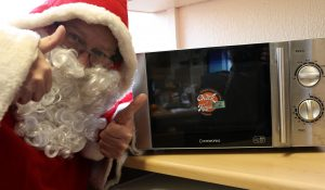 Father Christmas and Check it Twice sticker on a microwave