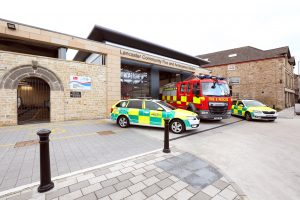 Lancaster Community Fire and Ambulance station with two rapid response vehicles and a fire engine parked in front