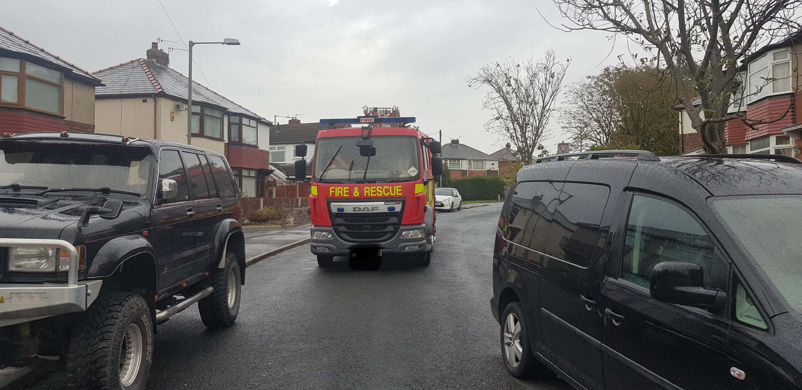 image showing fire engine unable to pass down a street between two cars