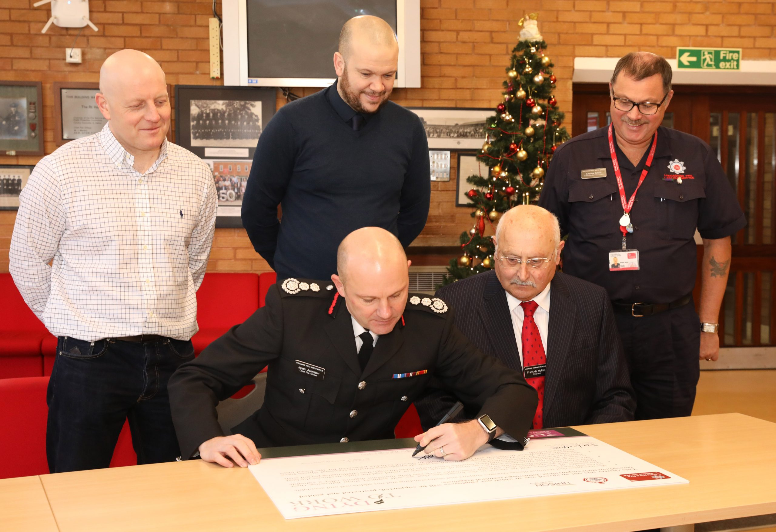 Justin Johnston, Frank de Molfetta, Andrew Smith, Sean Carlisle and TUC representative signing the Dying to Work Charter