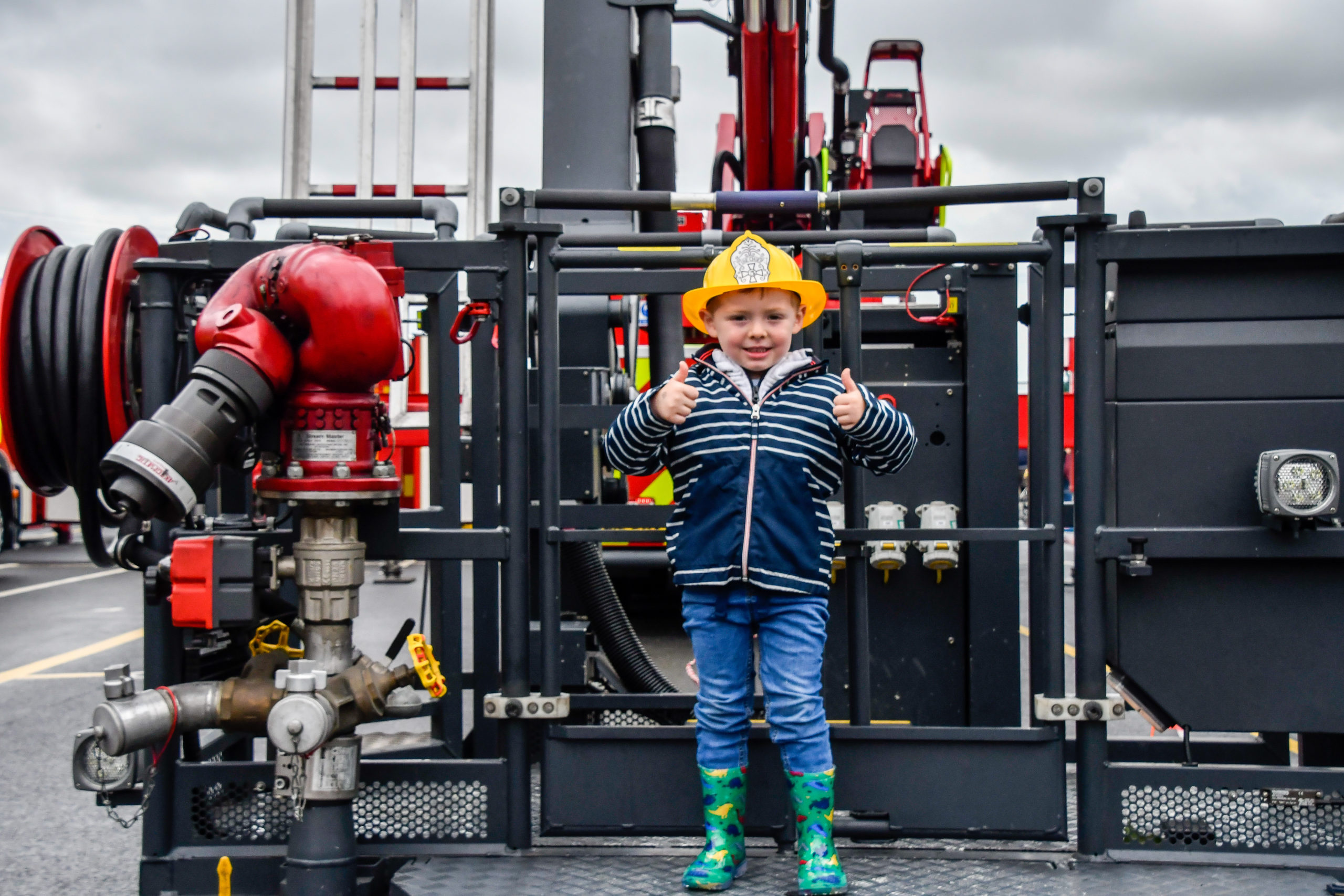 Small Boy with Firefighting Equipment